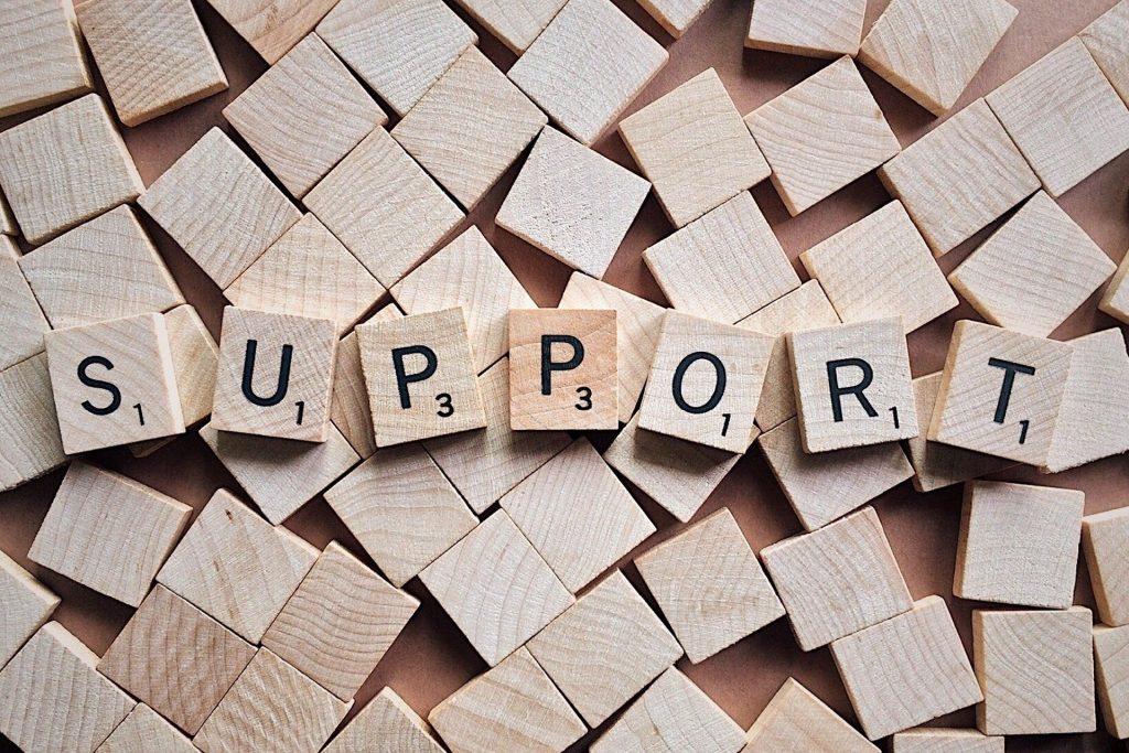 Scrabble tiles spelling 'support'